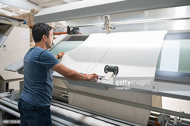 Textile quality controller checking fabrics