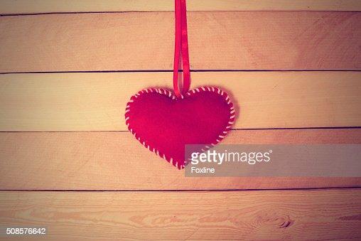 Textile red heart on a wooden texture : Bildbanksbilder