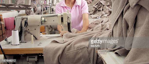 Textile worker is working on a sewing machine