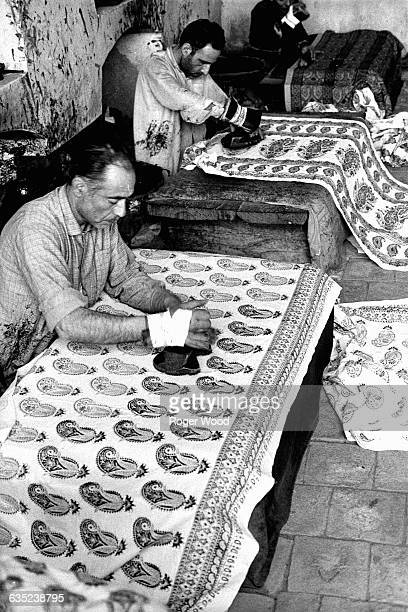 Textile workers handblock designs on cotton fabric in Isfahan Iran