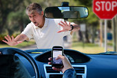 An irresponsible texting driver is about to run over a pedestrian at an intersection which shows how dangerous texting and driving is. Stop the text and stop the wrecks.