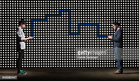 texting in front of lightwall