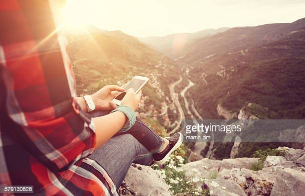 Texting on the mountain top