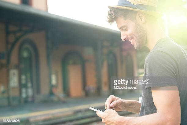 Texting while waiting for train.