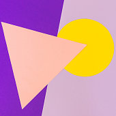Texture background of fashion pastel colors: pink, yellow and purple geometric pattern papers in minimal concept. Flat lay, Top view. 90s style