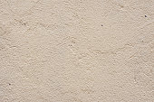 Texture Beige dyed cemented wall, softly lined. Exterior texture exterior finish of external walls. Textured beige background
