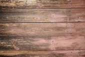 texture of an old wooden plaque dyed in a cherry blossom, a textur for a background.