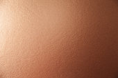 Texture of brown metallic foil paper background for design Christmas or New Year's or party cards