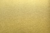 Texture of golden metal, abstract pattern background, selective focus