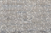 Texture of latin words engraved on a marble plaque