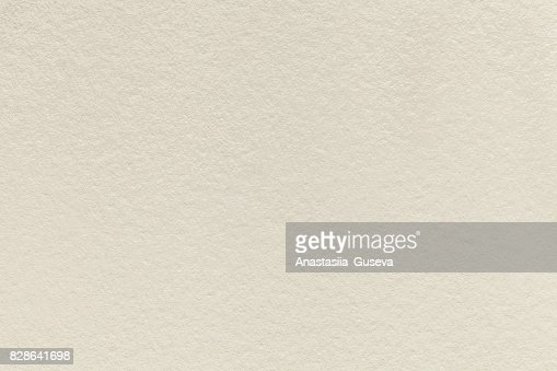 Texture of old light beige paper background, closeup. Structure of dense sand cardboard : Stock Photo