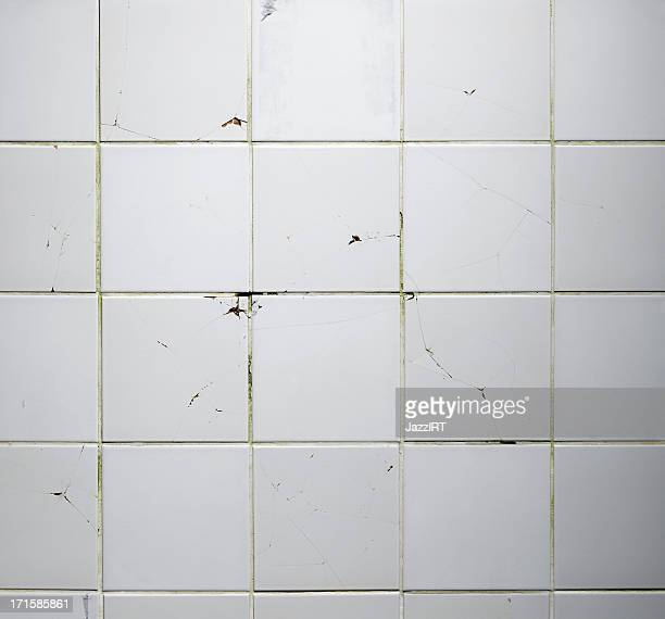 Texture of the old tile wall with cracks