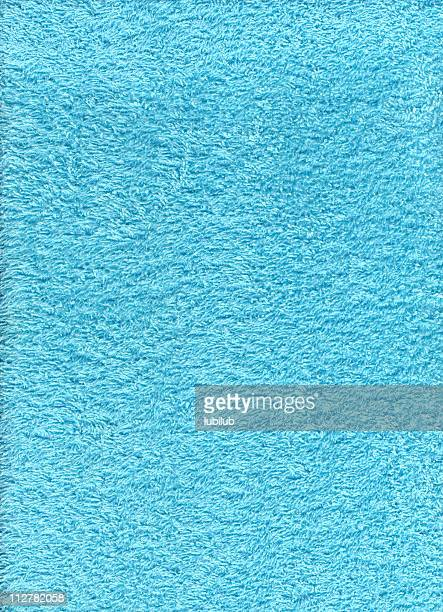 Texture of turquoise blue terry cloth towel
