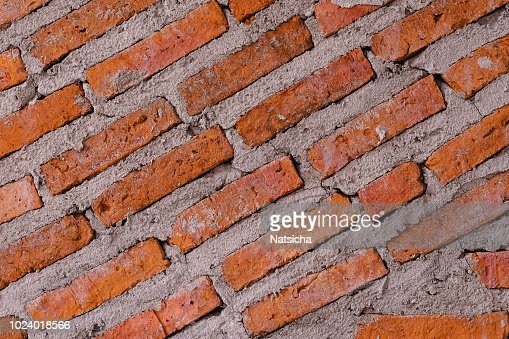 texture pattern of ed brick on cement wall use for background : Foto stock