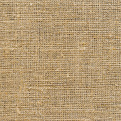 The texture of the burlap, closeup with yellow tint