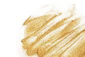 Textured background with golden glitter sparkle on white. Fashion, make up, nail art, shopping, cards