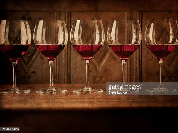 Large red wine glasses in a row