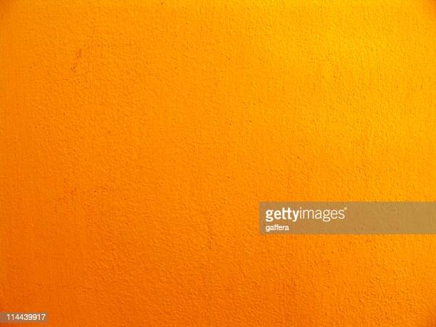 Textured multishaded orange wall
