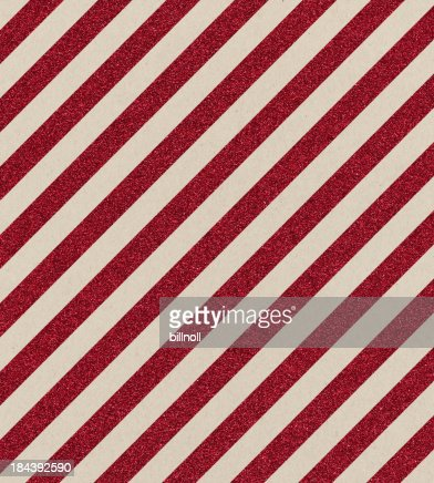 textured paper with red glitter stripe
