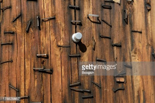 Textured Wood Pole With Rusted Staples Background