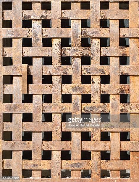 Textures of a metallic door of iron oxidized