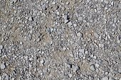 A close up view of the textures and pattern of the pebbles and stone in the gravel surface.
