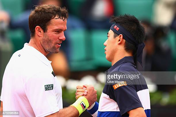 Teymuraz Gabashvili of Russia congratulates Kei Nishikori of Japan after their Men's Singles match on day eight of the 2015 French Open at Roland...