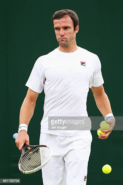 Teymuraz Gabashvili of Russia during his Gentlemen's Singles first round match against Tim Puetz of Germany on day one of the Wimbledon Lawn Tennis...
