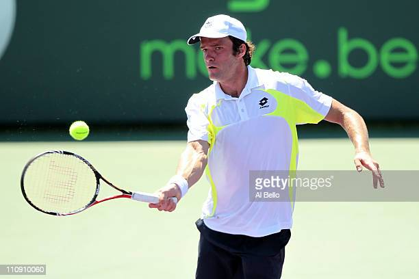 Teymuraz Gabashvili of Russia hits a forehand return against JoWilfried Tsonga of France during the Sony Ericsson Open at Crandon Park Tennis Center...