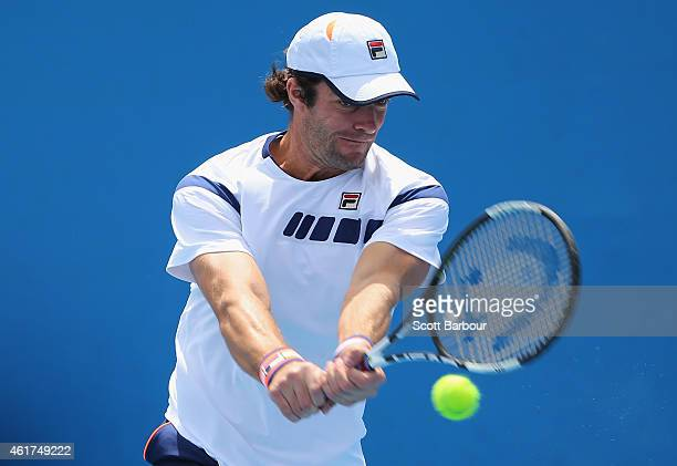 Teymuraz Gabashvili of Russia plays a backhand in his first round match against Marcos Baghdatis of Cyprus during day one of the 2015 Australian Open...