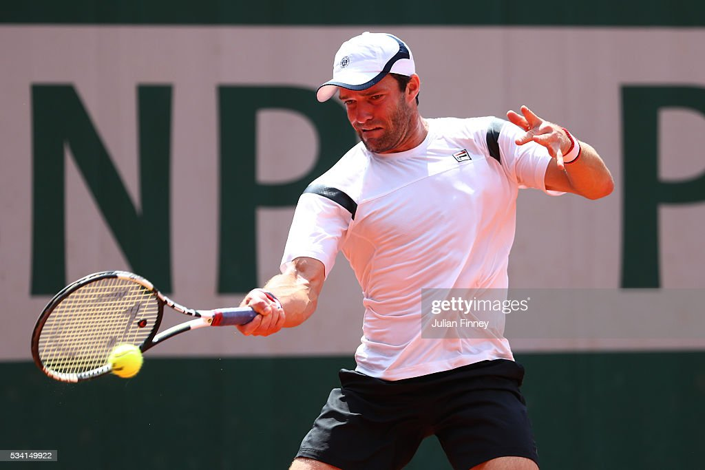 Teymuraz Gabashvili of Russia plays a forehand during the Men's Singles second round match against Benoit Paire of France on day four of the 2016 French Open at Roland Garros on May 25, 2016 in Paris, France.