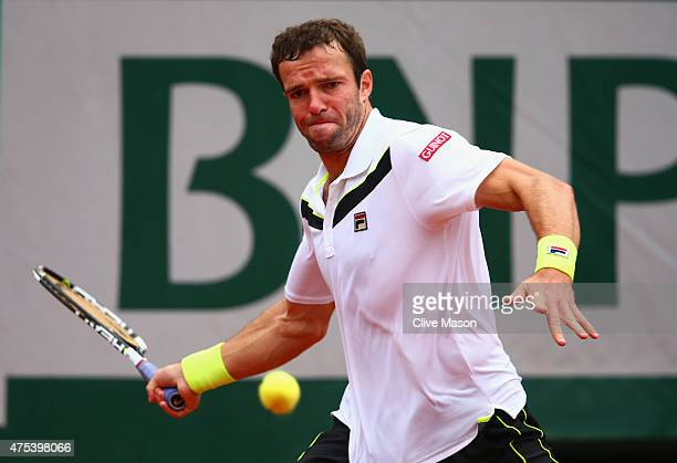 Teymuraz Gabashvili of Russia plays a forehand in his Men's Singles match against Kei Nishikori of Japan on day eight of the 2015 French Open at...