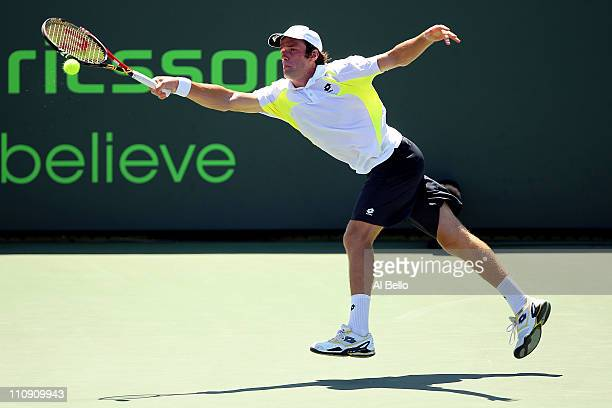 Teymuraz Gabashvili of Russia reaches for a return against JoWilfried Tsonga of France during the Sony Ericsson Open at Crandon Park Tennis Center on...