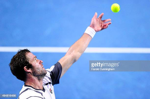 Teymuraz Gabashvili of Russia serves during the second day of the Swiss Indoors ATP 500 tennis tournament against Marin Cilic of Croatia at St...