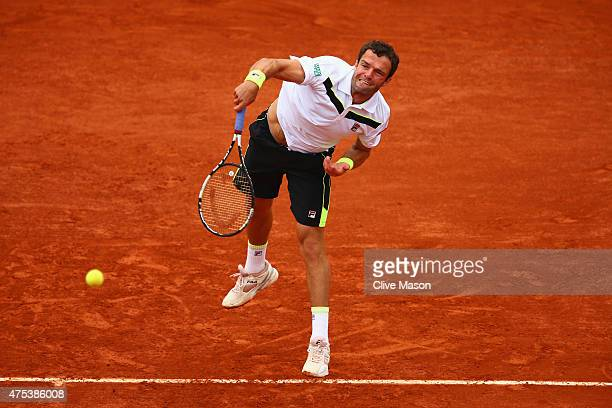 Teymuraz Gabashvili of Russia serves in his Men's Singles match against Kei Nishikori of Japan on day eight of the 2015 French Open at Roland Garros...