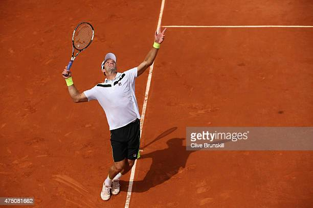 Teymuraz Gabashvili of Russia serves in his Men's Singles match against Lukas Rosol of Czech Republic on day six of the 2015 French Open at Roland...
