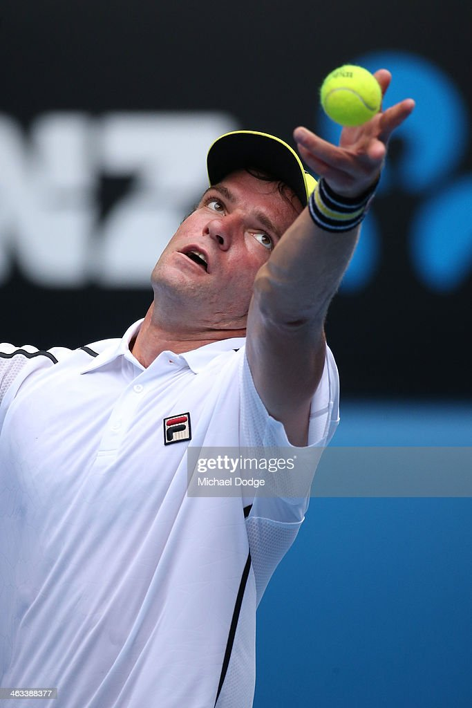 Teymuraz Gabashvili of Russia serves in his third round match against Roger Federer of Switzerland during day six of the 2014 Australian Open at Melbourne Park on January 18, 2014 in Melbourne, Australia.