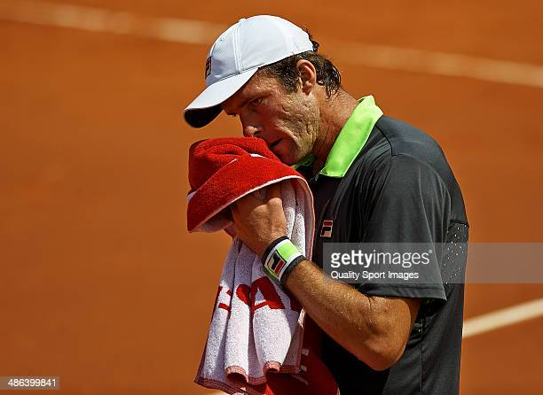 Teymuraz Gabashvili of Russia wipes his face in his match against David Ferrer of Spain during day three of the ATP Barcelona Open Banc Sabadell at...