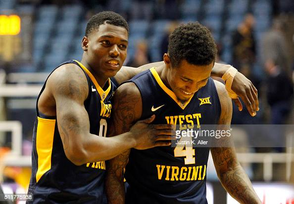 Teyvon Myers of the West Virginia Mountaineers and Daxter Miles Jr #4 of the West Virginia Mountaineers celebrates after defeating the Iowa State...