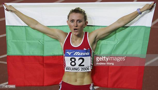 Tezdzhan Naimova of Bulgaria celebrates after winning the women's 200 meters final at the 11th IAAF World Junior Athletics Championships on August 18...