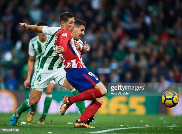 TFernando Torres of Club Atletico de Madrid competes for the ball with Zouhair Feddal of Real Betis Balompie during the La Liga match between Real...