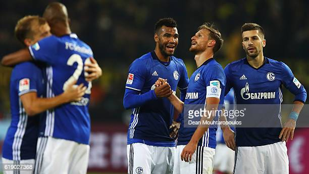 Th players of Schalke celebrate the draw after the Bundesliga match between Borussia Dortmund and FC Schalke 04 at Signal Iduna Park on October 29...