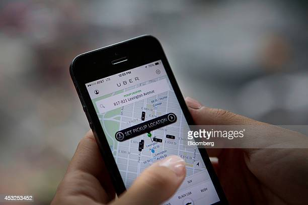 Th Uber Technologies Inc car service application is demonstrated for a photograph on an Apple Inc iPhone in New York US on Wednesday Aug 6 2014 For...