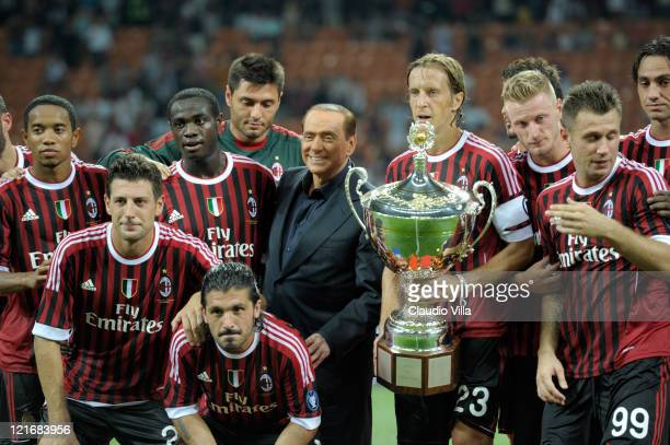 Tha players of AC Milan and AC Milan chairman Silvio Berlusconi celebrate after winning the Berlusconi Trophy during the Berlusconi Trophy match...