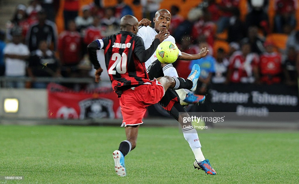 Thabo Matlaba of Orlando pirates battling for the ball with Henry Banda of Zanaco FC during the CAF Confedaration Cup match between Orlando Pirates and Zanaco at FNB Stadium on April 06, 2013 in Johannesburg, South Africa.