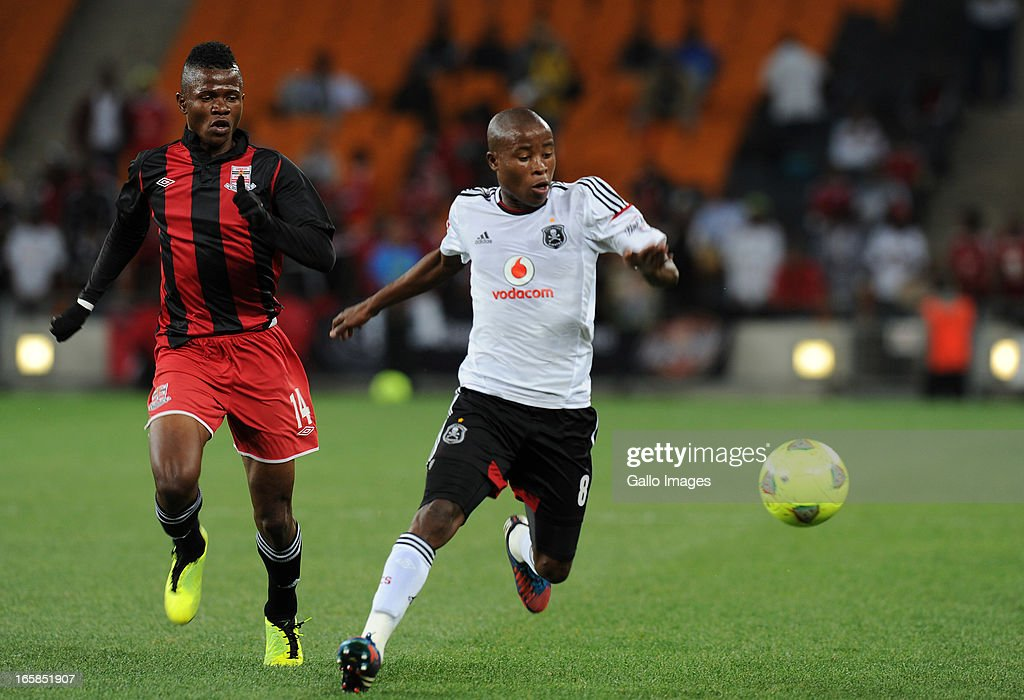 Thabo Matlaba of Orlando pirates battling for the ball with Rodrick Kwabe of Zanaco FC during the CAF Confedaration Cup match between Orlando Pirates and Zanaco at FNB Stadium on April 06, 2013 in Johannesburg, South Africa.