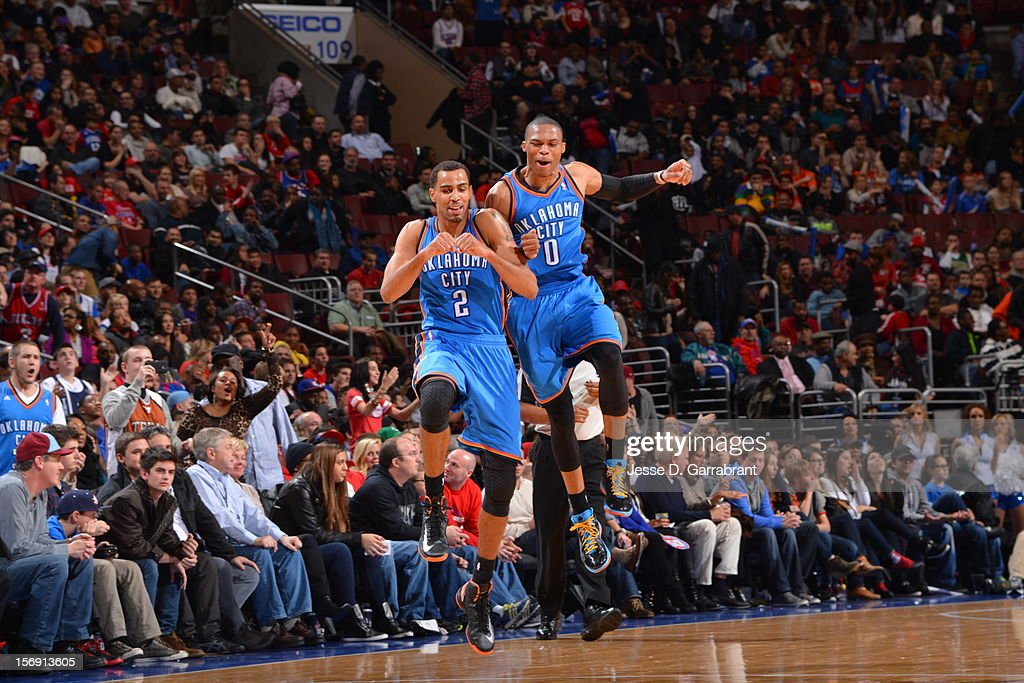Thabo Sefolosha #2 and Russell Westbrook #0 of the Oklahoma City Thunder get excited during the game vs the Philadelphia 76ers at the Wells Fargo Center on November 24, 2012 in Philadelphia, Pennsylvania.