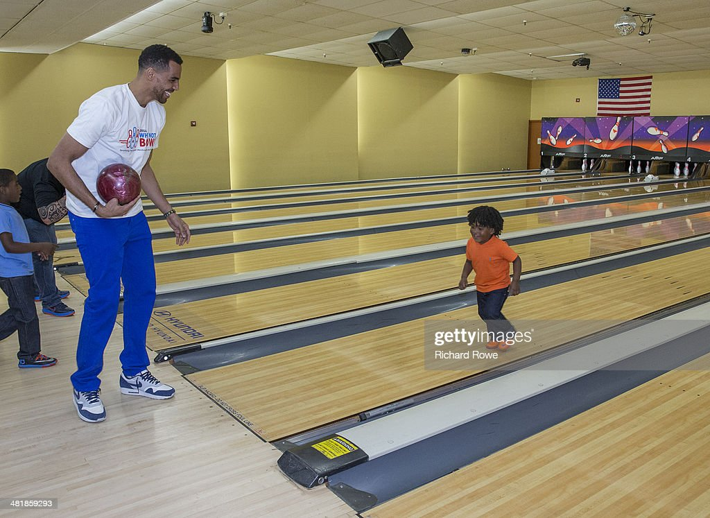 Thabo Sefolosha #25 joins Russell Westbrook #0 of the Oklahoma City Thunder at his annual Why Not Foundation fundraiser to benefit the Boys and Girls Club at AMC Boulevard Bowl in Edmond, Oklahoma.