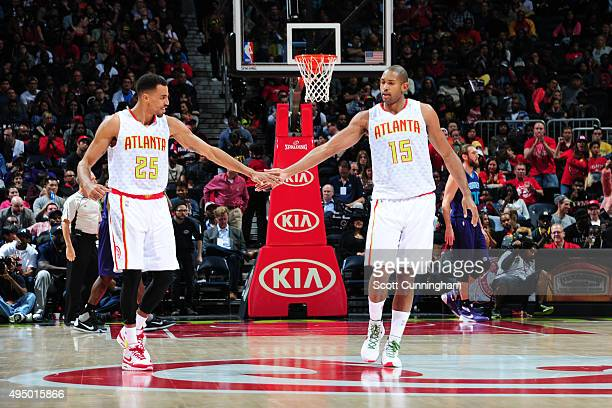 Thabo Sefolosha of the Atlanta Hawks celebrates a play with Al Horford of the Atlanta Hawks during the game against the Charlotte Hornets on October...