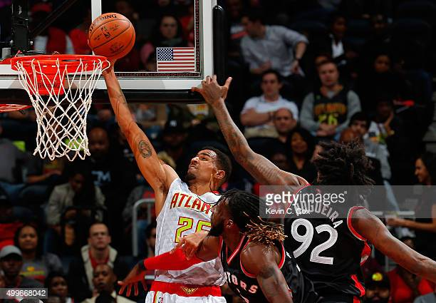 Thabo Sefolosha of the Atlanta Hawks dunks against Lucas Nogueira and DeMarre Carroll of the Toronto Raptors at Philips Arena on December 2 2015 in...